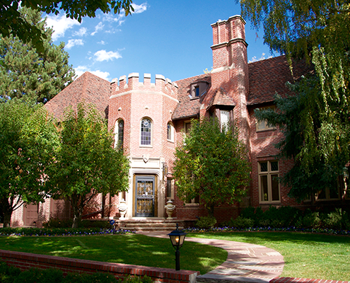 Large brick house with yard in Cherry Creek Country Club Denver.