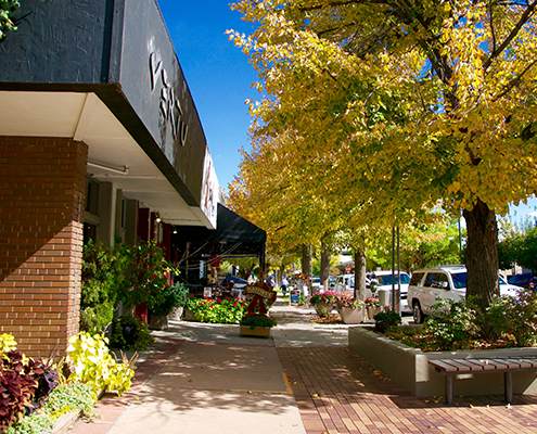 Outdoor shopping sidewalk and shops in Cherry Creek Denver.