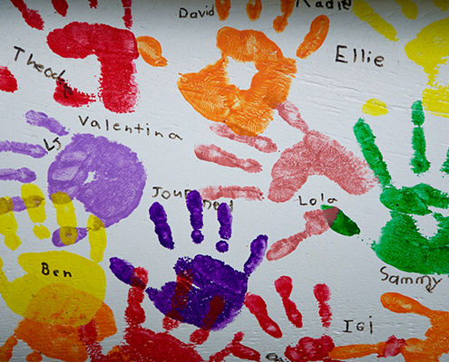 Children's painted handprints with names.