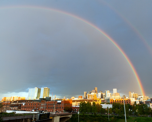 Rainbow over Downtown Denver skyline.