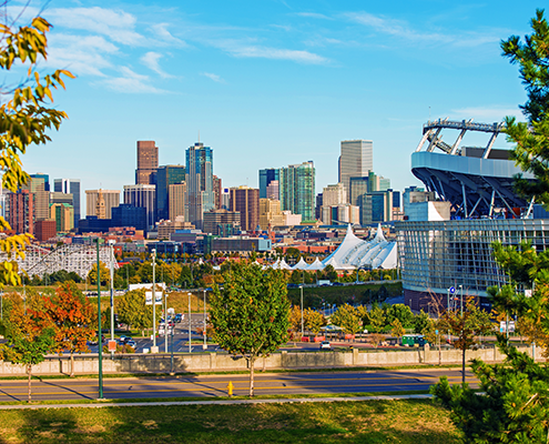 Downtown Denver city skyline and Sports Authority field.