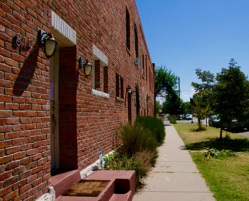 Old historic brick townhomes in Curtis Park Denver.