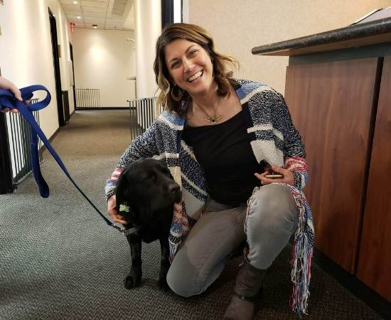 Allison Parks of Conscious Real Estate hangs out with a Freedom Service Dog