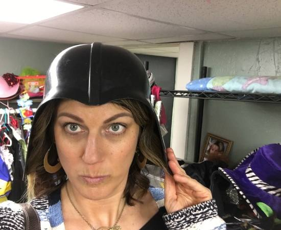 Conscious Real Estate Owner and Founder Allison Parks tries on a new look while on a day of donating.